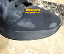 普拉达(PRADA)蓝黑色运动鞋布面烫伤织补图